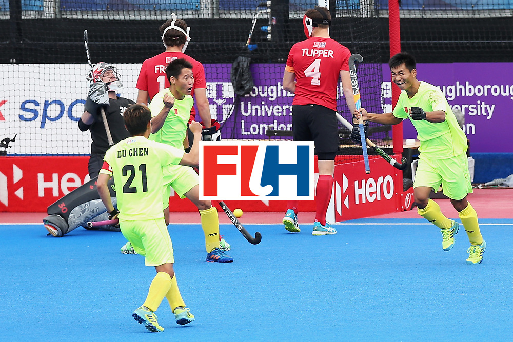 LONDON, ENGLAND - JUNE 24:  Wenhui E of China celebrates scoring his sides first goal with Talake Du of China and Chen Du of China during the 5th-8th place match between Canada and China on day eight of the Hero Hockey World League Semi-Final at Lee Valley Hockey and Tennis Centre on June 24, 2017 in London, England.  (Photo by Alex Morton/Getty Images)