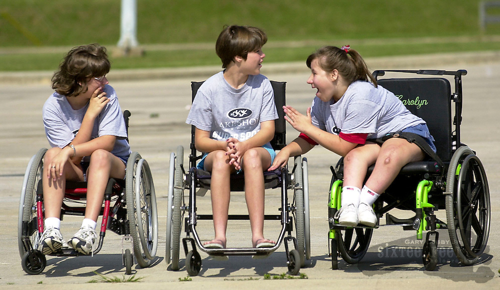 Contestants in a county Special Olympics event chat before a race in Decatur, Alabama.