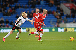 Rotherham's Ben Pringle tries to hold back Cardiff City's Matthew Connolly - Photo mandatory by-line: Alex James/JMP - Mobile: 07966 386802 - 06/12/2014 - SPORT - Football - Cardiff - Cardiff City Stadium  - Cardiff City v Rotherham United  - Football