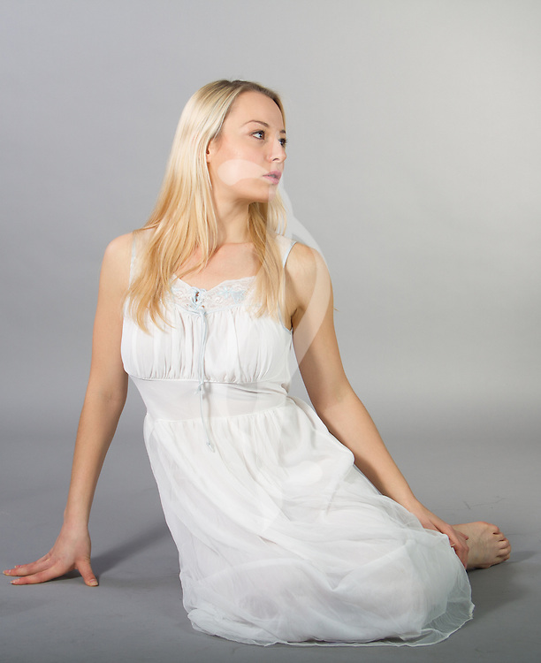 Female model posing in a bedgown.