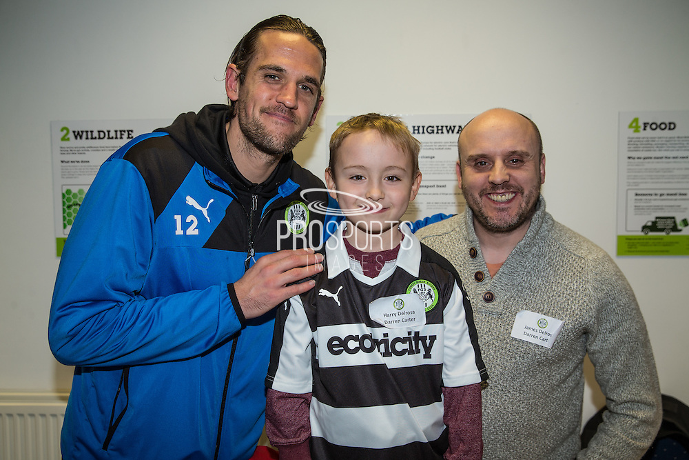 Forest Green Rovers Darren Carter(12) with his shirt sponsor during the Vanarama National League match between Forest Green Rovers and Macclesfield Town at the New Lawn, Forest Green, United Kingdom on 4 March 2017. Photo by Shane Healey.