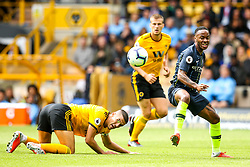 Raheem Sterling of Manchester City goes past Conor Coady of Wolverhampton Wanderers - Mandatory by-line: Robbie Stephenson/JMP - 25/08/2018 - FOOTBALL - Molineux - Wolverhampton, England - Wolverhampton Wanderers v Manchester City - Premier League
