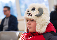 Merrick, New York, U.S.  December 20, 2019. JUSTIN MITKISH, 11, is wearing his Wampa hat, based on a Star Wars character, to book signing for STAR WARS: FORCE COLLECTOR at North Merrick Library on Nassau County Force Collector Day. Author Kevin Shinick named the home planet of Karr Nuq Sin, the main character of this canon Star Wars young adult novel, MEROKIA in honor of Merokee tribe who settled his Merrick hometown on Long Island.