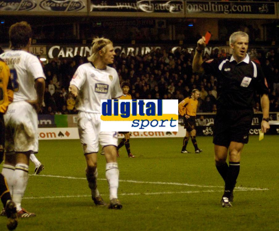 Photo: Leigh Quinnell.<br /> Wolverhampton Wanderers v Leeds United. Coca Cola Championship. 17/12/2005. Referee C.Foy sends off Leeds' Simon Walton.(far left)