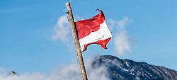 THEMENBILD - die Österreichische Flagge weht an einem Fahnenmast. Die Grossglockner Hochalpenstrasse verbindet die beiden Bundeslaender Salzburg und Kaernten mit einer Laenge von 48 Kilometer und ist als Erlebnisstrasse vorrangig von touristischer Bedeutung, aufgenommen am 15. September 2016, Bruck a. d. Glocknerstrasse, Oesterreich // Austrian flag waving on a flag pole. The Grossglockner High Alpine Road connects the two provinces of Salzburg and Carinthia with a length of 48 km and is as an adventure road priority of tourist interest at Bruck a. d. Glocknerstrasse, Austria on 2016/09/15. EXPA Pictures © 2016, PhotoCredit: EXPA/ JFK