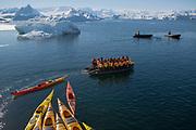 Crystal Sound, Antarctic Peninsula, Antarctica - A zodiac pulls kayaks as it takes tourists to go kayaking in Crystal Sound. <br />  ©Ann Inger Johansson/zReportage/Exclusivexpix media