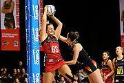Tactix goal shoot Ellie Bird takes a pass under pressure from Magic goal keep Kate Llyod during the ANZ Premiership netball match - Magic v Tactix played at Claudelands Arena, Hamilton, New Zealand on 30 July 2018.<br /> <br /> Copyright photo: &copy; Bruce Lim / www.photosport.nz
