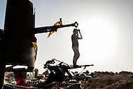 Libya: Standing on the barrels of a heavy machine gun a Libya's Government of National Accord's (GNA) fighter watch ISIS positions in Sirte. Alessio Romenzi