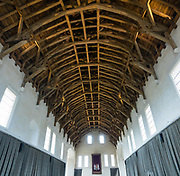 The Great Hall in Stirling Castle was the largest medieval banqueting room ever built in Scotland. The Great Hall was thoroughly rebuilt 1969-1999, including timber from 350 Strathyre oak trees pinned together with 4000 handmade pegs for the hammerbeam roof. Originally completed for James IV in 1503, it has four pairs of tall windows at the dais end, where the king and queen sat, and was heated by five large fireplaces. In 1594, for the baptism of his son Prince Henry, James VI held a banquet here so lavish that the fish course was served from an enormous model wooden ship 18 feet long with masts 40 feet high, complete with firing cannons. Historically, Stirling controlled a strategic position (until the 1890s) as the lowest bridging point of the River Forth before it broadens towards the Firth of Forth, making it the gateway to the Scottish Highlands. One of the principal royal strongholds of the Kingdom of Scotland, Stirling was created a royal burgh by King David I in 1130. Before the union with England, Stirling Castle was also one of the most used of the many Scottish royal residences, serving as both a palace and a fortress. Several Scottish Kings and Queens have been crowned at Stirling, including Mary, Queen of Scots in 1542, and others were born or died there. Stirling Castle has suffered at least eight sieges, including several during the Wars of Scottish Independence. This image was stitched from several overlapping photos.