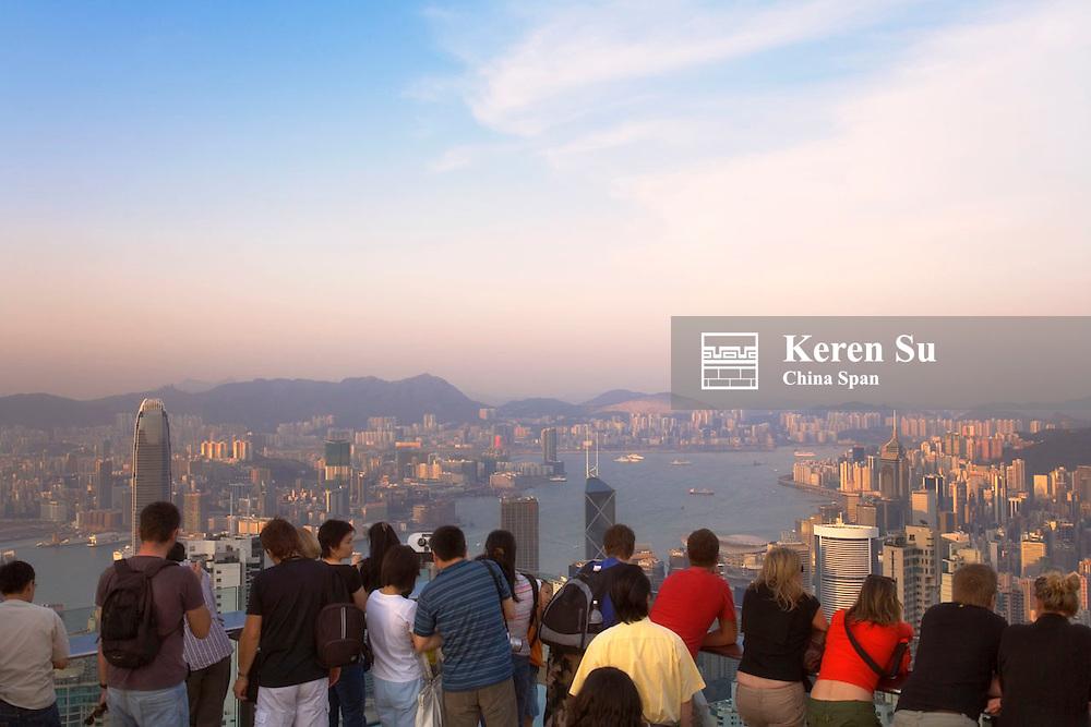 Tourists watch skyline of Hong Kong, Hong Kong, China