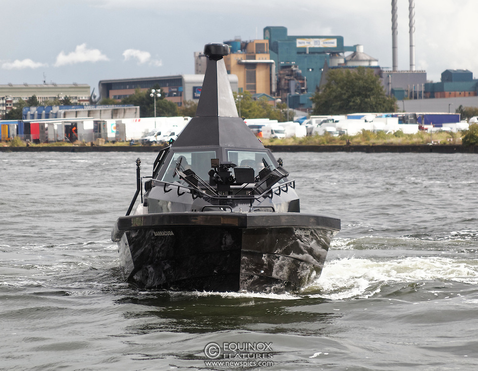 London, United Kingdom - 18 September 2015<br /> Safehaven Marine demonstrate their SV11 Barracuda stealth boat with front mounted retractable gun and radar avoidance technology at Operation MARICAP waterborne demonstration at the defence and security exhibition DSEI at ExCeL, Woolwich, London, England, UK.<br /> (photo by: EQUINOXFEATURES.COM)<br /> <br /> Picture Data:<br /> Photographer: Equinox Features<br /> Copyright: &copy;2015 Equinox Licensing Ltd. +448700 780000<br /> Contact: Equinox Features<br /> Date Taken: 20150918<br /> Time Taken: 14344129<br /> www.newspics.com