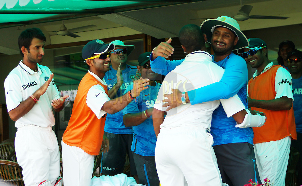 Shikhar Dhawan of India is cheered as he enters the dressing room after his century on debut during day 3 of the 3rd Airtel Test Match between India and Australia held at the PCA Stadium, Mohali, India on the 16th March 2013..Photo by Ron Gaunt/BCCI/SPORTZPICS ..Use of this image is subject to the terms and conditions as outlined by the BCCI. These terms can be found by following this link:..http://www.sportzpics.co.za/image/I0000SoRagM2cIEc