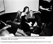 Megan Byrne ( black dress ) &amp; Jen Gatien at the Gold and Silver Ball. Palladium. New York. 17 December 1989. Film. 89658f20<br />&copy; Copyright Photograph by Dafydd Jones. 66 Stockwell Park Rd. London SW9 0DA. Tel 0171 733 0108