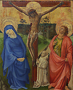 Calvary with a Carthusian monk, with Christ on the cross and a kneeling monk representing the Chartreuse de Champmol, which commissioned the work, the Virgin Mary and St John the Baptist, by an unknown artist, after 1433, after Jean de Beaumetz, 1335-96, oil painting on wood, in the Musee des Beaux-Arts de Dijon, opened 1787 in the Palace of the Dukes of Burgundy in Dijon, Burgundy, France. This painting is a copy of one of a series painted in 1386 by Jean de Beaumetz to decorate the monks' cells. It may have been made to decorate new cells built in 1433 under Isabella of Portugal, wife of Philip the Good. Picture by Manuel Cohen