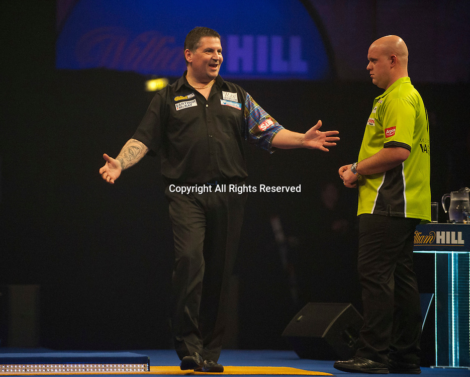 03.01.2015.  London, England.  William Hill PDC World Darts Championship.  Semi Final Round.  Gary Anderson (4) [SCO] celebrates a winning leg in his match with Michael van Gerwen (1) [NED].  Gary Anderson won the match 6-3.