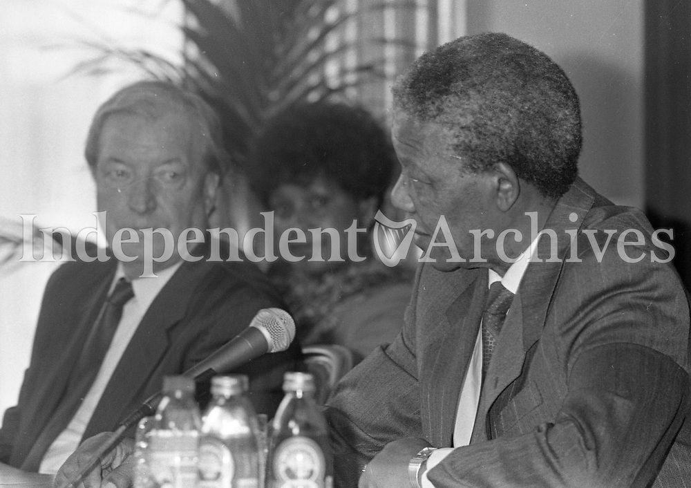 Nelson Mandela is pictured at the joint press conference with An Taoiseach Charles J Haughey at Dublin Castle, also pictured is Winnie Mandela, 02/07/1990 (Part of the Independent Newspapers Ireland/NLI Collection).