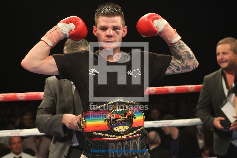Winner Dave Ryan  (White/Silver Shorts)  of the Vacant Commonwealth Light Welterweight title bout at the First Direct Arena, Leeds<br /> Picture by Stephen Gaunt/Focus Images Ltd +447904 833202<br /> 04/10/2014