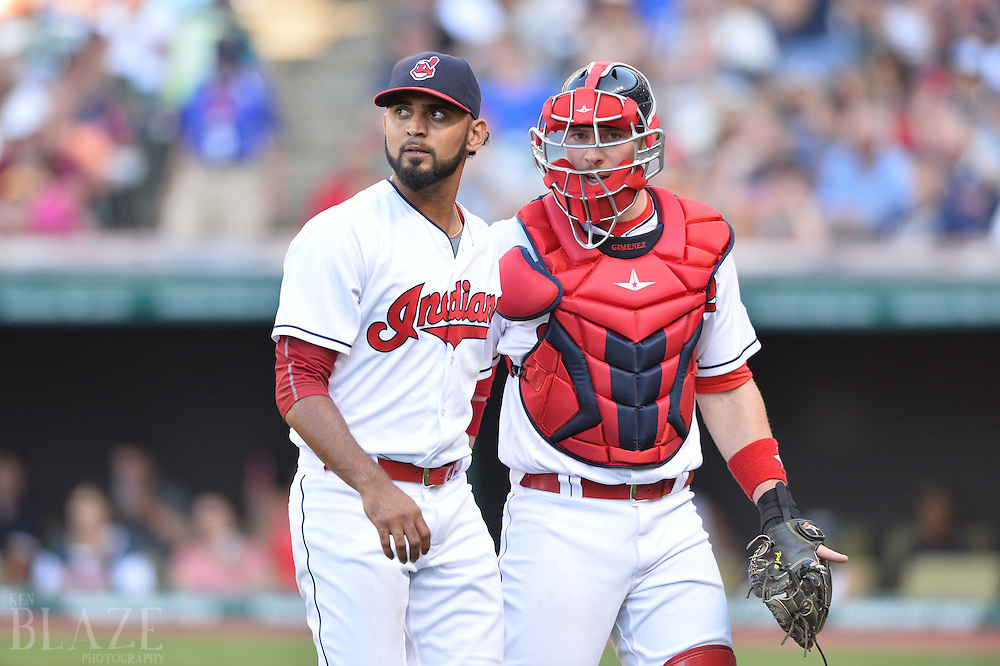 Sep 4, 2016; Cleveland, OH, USA; Cleveland Indians starting pitcher Danny Salazar (31) and Cleveland Indians catcher Chris Gimenez (38) walk off the field during the fifth inning against the Miami Marlins at Progressive Field. Mandatory Credit: Ken Blaze-USA TODAY Sports