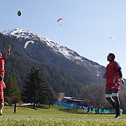 The Georgian team training at Recreation Park, Queenstown, in preparation for the IRB Rugby World Cup as paragliders descending from skyline lookout, prepare to land in a nearby field. Queenstown, New Zealand, 7th September 2011. Photo Tim Clayton..