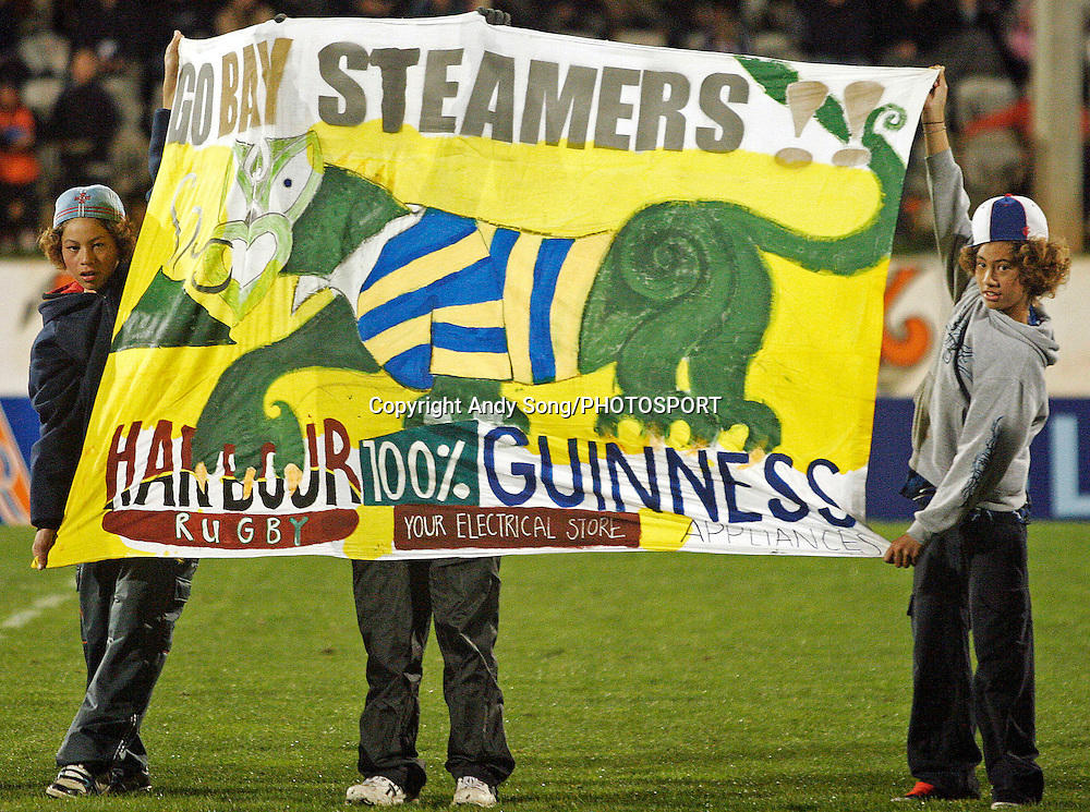 Fans with their banners in the banner competition during the Air New Zealand Cup week 3 rugby union match between Bay of Plenty and North Harbour at Blue Chip Stadium in Mt Maunganui, New Zealand on Saturday 12 August 2006. Harbour won the match 25:7. Photo: Andy Song/PHOTOSPORT