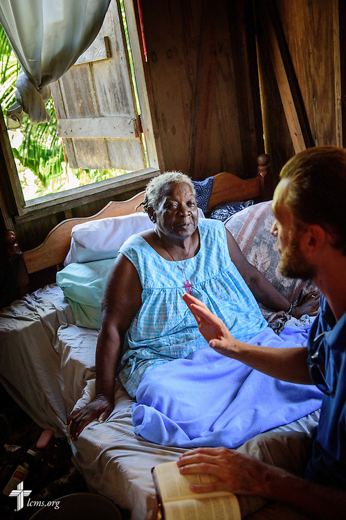 Lovina listens as the Rev. Duane Meissner, career missionary to Belize, reads a devotion and Scripture during a visit to her home on Tuesday, Sept. 27, 2016, in the village of Seine Bight, Belize. Meissner's objective is to plant the first Lutheran churches in the country. LCMS Communications/Erik M. Lunsford