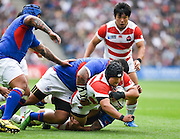 Japan prop Kensuke Hatakeyama is tackled during the Rugby World Cup Pool B match between Samoa and Japan at stadium:mk, Milton Keynes, England on 3 October 2015. Photo by David Charbit.