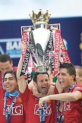 WIGAN, ENGLAND - Sunday, May 11, 2008: Manchester United's Ryan Giggs lifts the trophy with team-mates Cristiano Ronaldo (R) and Carlos Tevez (L) after winning the Premier League after the final Premiership match of the season at the JJB Stadium. (Photo by David Rawcliffe/Propaganda)