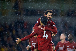 WOLVERHAMPTON, ENGLAND - Friday, December 21, 2018: Liverpool's Mohamed Salah (top) celebrates scoring the first goal with team-mate Virgil van Dijk during the FA Premier League match between Wolverhampton Wanderers FC and Liverpool FC at Molineux Stadium. (Pic by David Rawcliffe/Propaganda)