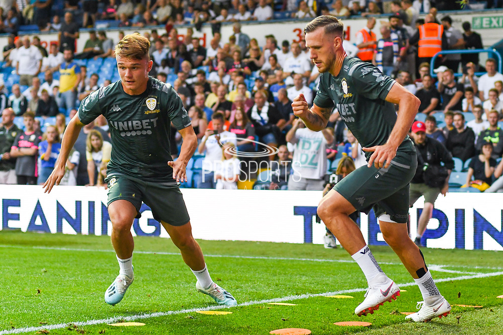 Leeds United midfielder Jamie Shackleton (46) ands Leeds United defender Barry Douglas (3) warming up during the EFL Cup match between Leeds United and Stoke City at Elland Road, Leeds, England on 27 August 2019.