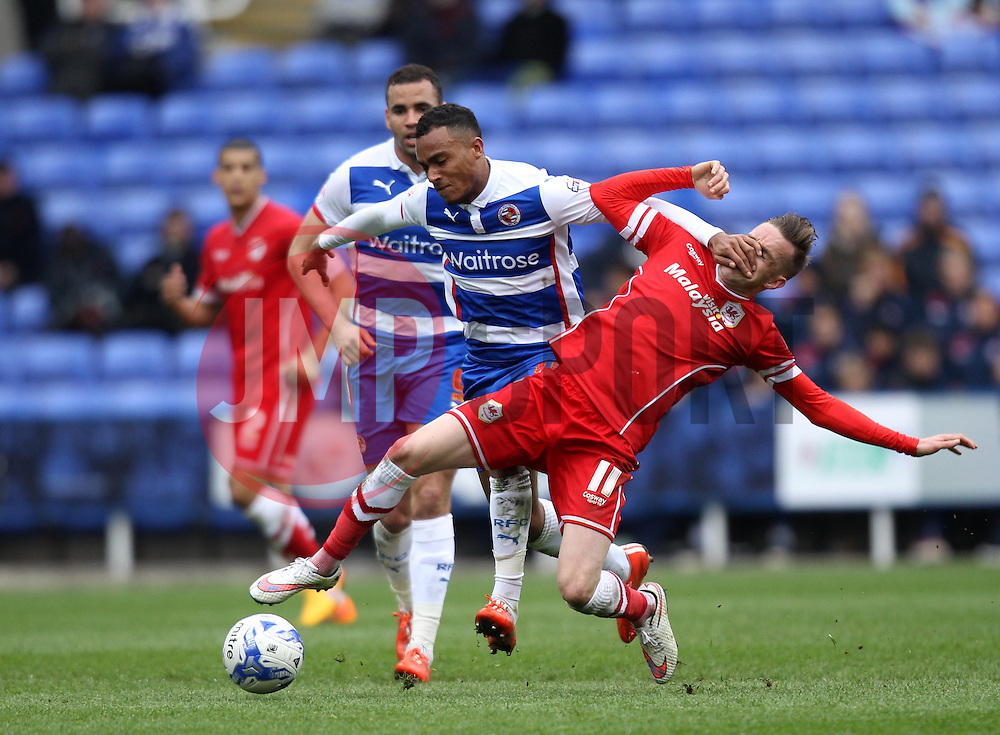 Reading's Jordan Obita hands off Cardiff City's Craig Noone - Photo mandatory by-line: Robbie Stephenson/JMP - Mobile: 07966 386802 - 04/04/2015 - SPORT - Football - Reading - Madejski Stadium - Reading v Cardiff City - Sky Bet Championship