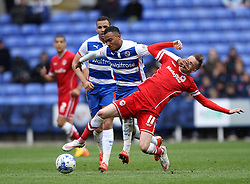 Reading's Jordan Obita hands off Cardiff City's Craig Noone - Photo mandatory by-line: Robbie Stephenson/JMP - Mobile: 07966 386802 - 04/04/2015 - SPORT - Football - Reading - Madejski Stadium - Reading v Cardiff City - Sky Bet Championship