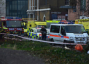 © Licensed to London News Pictures. 16/01/2013. London, UK Police and emergency services at the scene. A damaged crane is seen hanging from the side of the St George's Wharf development near Vauxhall in in London today (16/01/13) after a being hit by a helicopter, which then crashed.  Photo credit : Stephen Simpson/LNP