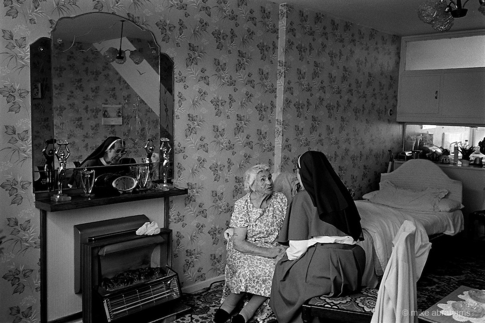 Anglican nun visiting members of the community in East London.