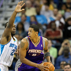 December 30, 2011; New Orleans, LA, USA; Phoenix Suns center Channing Frye (8) is guarded by New Orleans Hornets power forward Carl Landry (24) during the a game at the New Orleans Arena. The Suns defeated the Hornets 93-78.   Mandatory Credit: Derick E. Hingle-US PRESSWIRE