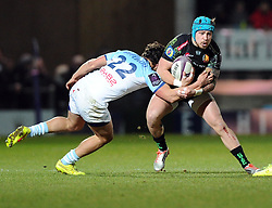 Bayonne Matthieu Ugalde  tackles Exeter Chiefs' Outside Centre, Jack Nowell  - Photo mandatory by-line: Joe Meredith/JMP - Mobile: 07966 386802 - 24/01/2015 - SPORT - Rugby - Exeter - Sandy Park Stadium - Exeter Chiefs v Bayonne - Challenge Cup Round 6