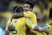 Hurricanes' Julian Savea celebrates the Hurricanes win with Hurricanes' Dane Coles during the round 14 Super Rugby match. Hurricanes v Chiefs. Westpac Stadium, Wellington. 16th May 2015. Copyright Photo.: Grant Down / www.photosport.co.nz