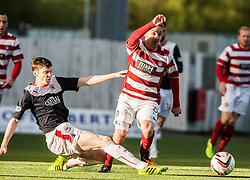 Falkirk's Conor McGrandles and Hamilton's Jon Routledge.<br /> Falkirk 1 v 1 Hamilton, Scottish Premiership play-off semi-final first leg, played 13/5/2014 at the Falkirk Stadium.