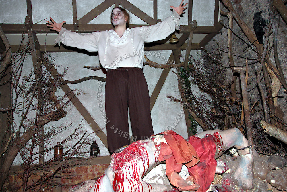 Actor during a play in one of the rooms inside the London Dungeon, England, on Thursday, Oct. 12, 2006. The London Dungeon is a live theatre attraction where visitors are taken by the actors through different areas featuring the darkest parts of British history. Some of the more than 40 exhibits include 'The Great Fire of London', 'Jack the Ripper', 'Judgement Day', 'The Torture Chamber', 'Henry VIII', 'The Tower of London' and 'The French Revolution'. In 2003 a new part opened focused on the Great Plague of 1665.   **Italy Out**..