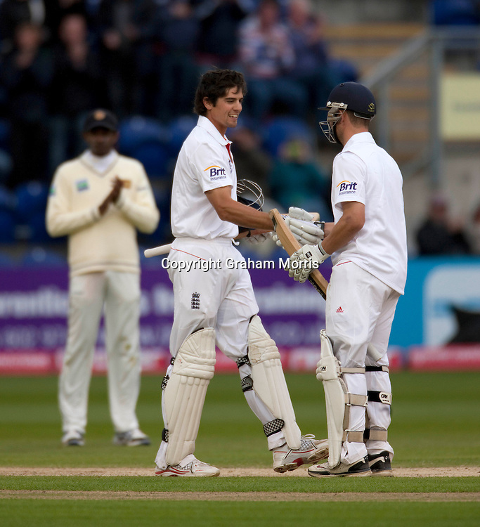 Alastair Cook reaches his century (soon to be followed by Jonathan Trott, right) during the first npower Test Match between England and Sri Lanka at the SWALEC Stadium, Cardiff.  Photo: Graham Morris (Tel: +44(0)20 8969 4192 Email: sales@cricketpix.com) 28/05/11