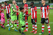 Forest Green Rovers Under 8's Academy players walk out with the teamduring the EFL Trophy match between Forest Green Rovers and U21 Southampton at the New Lawn, Forest Green, United Kingdom on 3 September 2019.