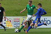 Nathan Collins of Republic of Ireland (5) is challenged by Dino Islamovic of Bosnia and Herzegovina (3) during the UEFA European Under 17 Championship 2018 match between Bosnia and Republic of Ireland at Stadion Bilino Polje, Zenica, Bosnia and Herzegovina on 11 May 2018. Picture by Mick Haynes.
