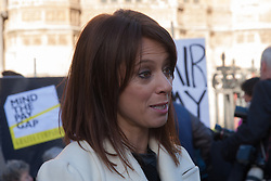 Westminster, London, December 16th 2014. Labour's Shadow Minister for Women and Equalities speaks to the media outside Parliament as women press for MPs for legislation on pay transparency.