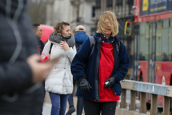 © Licensed to London News Pictures. 01/01/2020. London, UK. Windy weather in the capital as members of public walk on Westminster Bridge.  Photo credit: Dinendra Haria/LNP