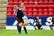 St Johnstone defender Brian Easton (#24) and Partick Thistle midfielder Chris Erskine (#10) battle for the ball during the Betfred Scottish Cup match between St Johnstone and Partick Thistle at McDiarmid Stadium, Perth, Scotland on 8 August 2017. Photo by Craig Doyle.