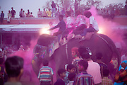 A mounted elephant takes part in a paint powder fight on the eve of Holi festival in the city of Jaipur, Rajasthan, India
