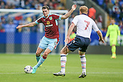 Michael Keane (Burnley) takes on Chris Taylor (Bolton Wanderers) but is fouled and awarded a free kick during the Pre-Season Friendly match between Bolton Wanderers and Burnley at the Macron Stadium, Bolton, England on 26 July 2016. Photo by Mark P Doherty.