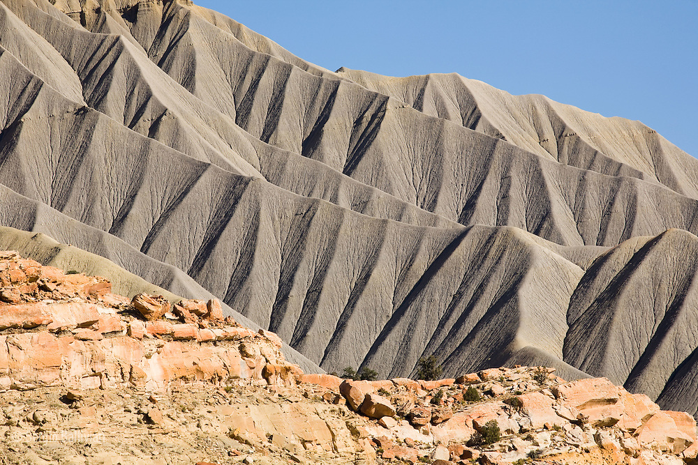 Layers of geologic time are depicted by different kinds of rock layers that have been eroded over time as seen in Capitol Reef National Park.