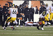 Cincinnati Bengals outside linebacker Vontaze Burfict (55) dives and tackles Pittsburgh Steelers wide receiver Markus Wheaton (11) who fumbles the ball, recovered by Cincinnati Bengals strong safety George Iloka (43), during the second quarter of the NFL AFC Wild Card playoff football game against the Pittsburgh Steelers on Saturday, Jan. 9, 2016 in Cincinnati. The Steelers won the game 18-16. (©Paul Anthony Spinelli)