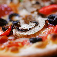 A capricciosa pizza with italian sausages, onions, olives, roasted peppers and added pepperoni is photographed at La Trattoria Bella Luna cucina italiana is on Thursday, June 12, 2009. The restaurant is located in a shopping center at the intersection of Cathedral Canyon and Ramon Road in Cathedral City. Crystal Chatham, The Desert Sun