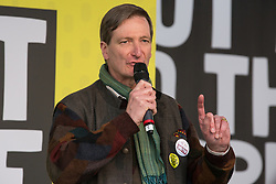 London, UK. 23rd March, 2019. Dominic Grieve, Conservative MP for Beaconsfield, addresses a million people taking part in a People's Vote rally in Parliament Square following a march from Park Lane.